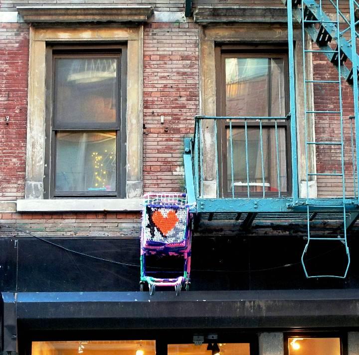 """Olek street art suspended from Lower East Side fire escape"""
