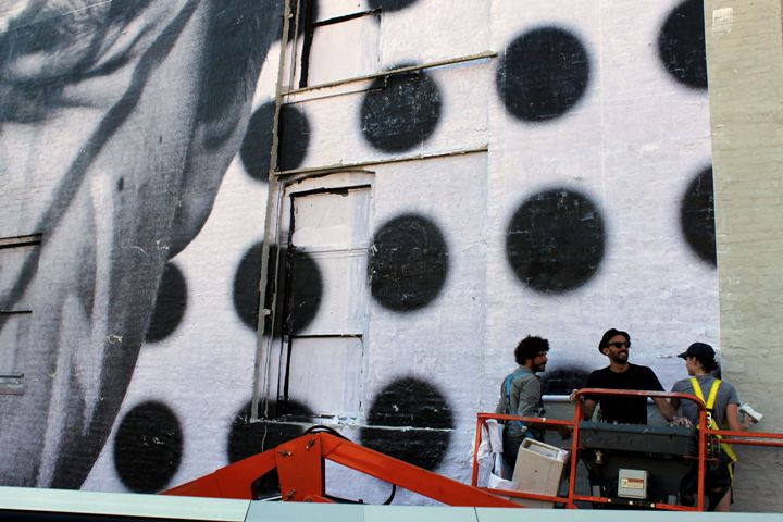 JR street art action NYC Award Winning Photographer/Artist JR in Manhattans Chelsea