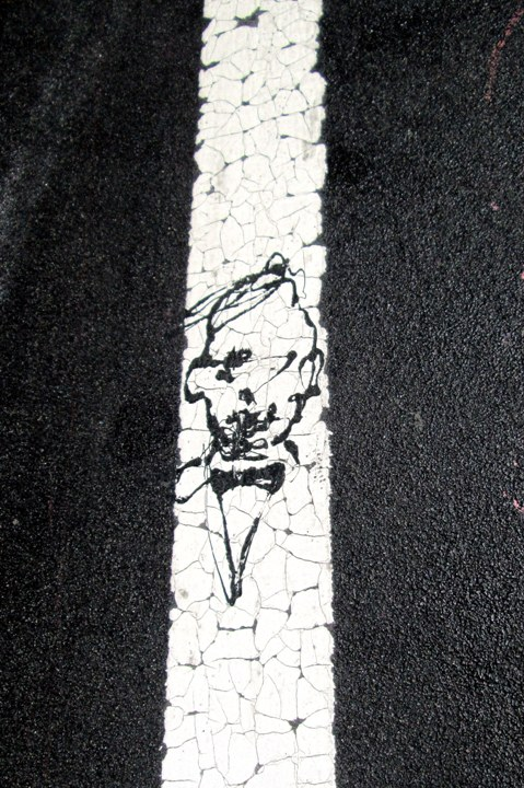 Paul Richard street art on Williamsburg Bridge pavement A Walk on the Williamsburg Bridge: Swampy, JR, Stikman, Quel Beast, Burning Candy, Invader, Cash4, Paul Richard, Veng RWK & more