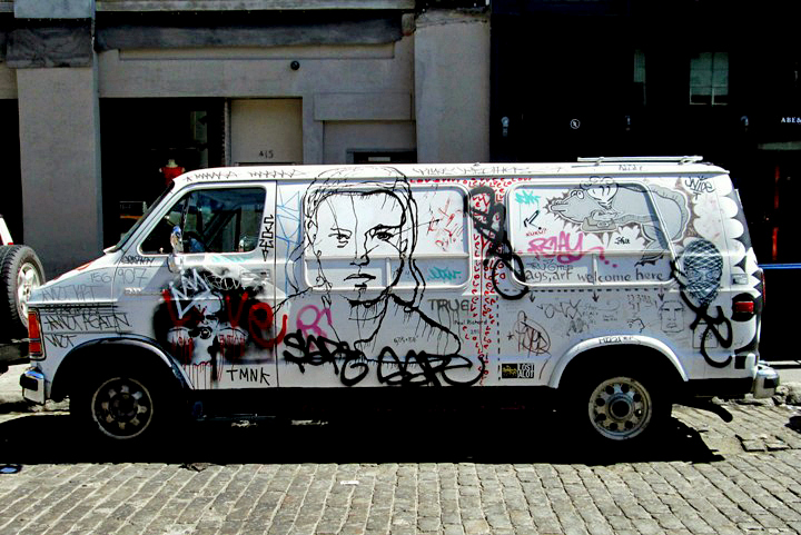 """Manhattan van with street art images"""