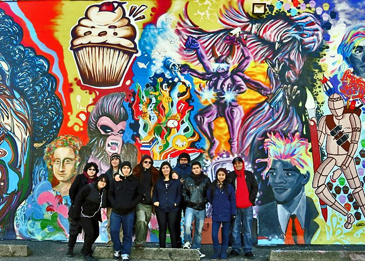 Fumero and students in Passaic New Jersey NYC artists Zimad, Sien, Sen2 & Fumero, along with high school students, fashion vibrant mural in Passaic, NJ