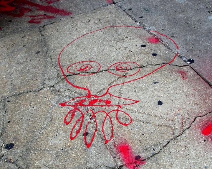 UFO street art icon on NYC pavement NYCs Dashing Pavement Art