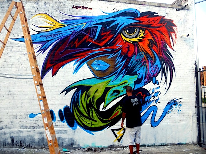 logik one paints at welling court 4th Annual Welling Court Mural Project Kicks off Tomorrow with Wondrous Art and Huge Block Party
