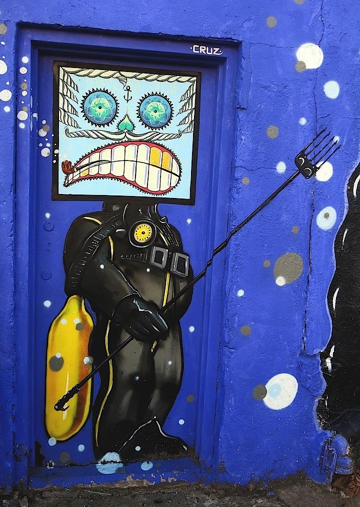 cruz street art nyc NYC's Expressive Doors, Part II: Reme821, Gaia, Abel Macias, SinXero, Cruz, Sonni, OCMC and Judith Supine