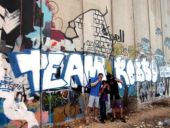 Devi-graffiti-with-Banksy-street-art-Palestine