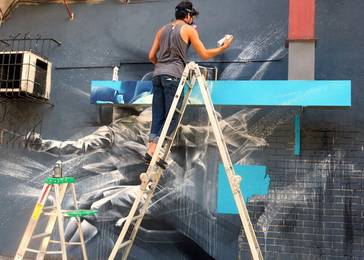 Li Hill paints street art Jersey City Back to Jersey City with Alice Pasquini, Mr. Mustart, Li Hill, Ekundayo, Sean Lugo, and Case MaClaim