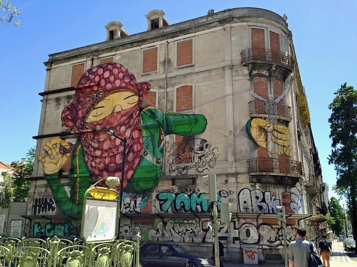Os-Gemeos-and-Blu-street-art-Lisbon
