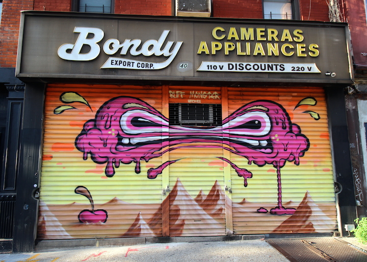 buff monster street art shutter LES NYC 100 Gates Public Art Project: Mas Paz, Damien Mitchell, Billy the Artist, Ida Noelle, Abigail Kaage, Claw Money & Miss 17, Faust & Shantell Martin, Jessica Deutch and Buff Monster