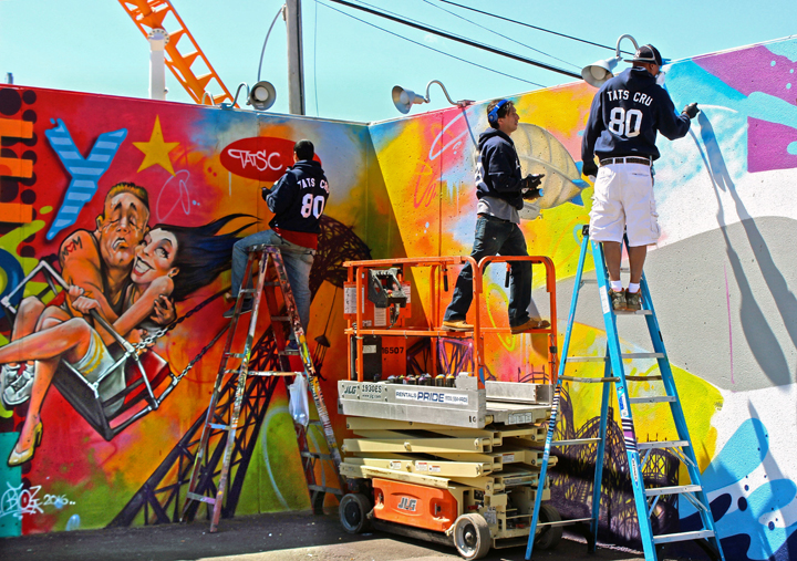 tats Cru paints Coney art walls Coney Island Public Art Wall Project Returns This Weekend with: Tats Cru, Icy and Sot, Lady Aiko, Eric Haze, Pose, Mister Cartoon, Daze, Crash, John Ahearn, Nina Chanel and more