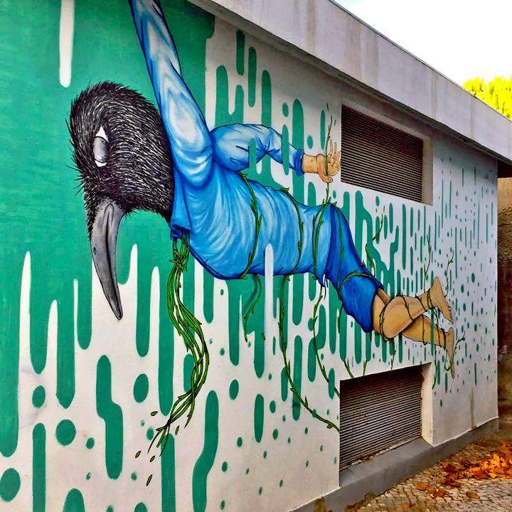 2CarryOn mural art Lisbon In Bairro Padre Cruz: Miguel RAM, Borondo, TelmoMiel, Mr Dheo, Spok Brillor, André NADA, Daniel Eime and 2CarryOn