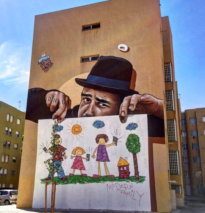 Mr Dheo street art mural lisbon In Bairro Padre Cruz: Miguel RAM, Borondo, TelmoMiel, Mr Dheo, Spok Brillor, André NADA, Daniel Eime and 2CarryOn