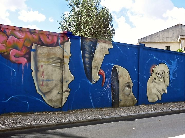 drawing jesus street art mural art In Lisbon, Portugal: Faces on the Blue Wall with Drawing Jesus, Francisco Camilo, Trafic, Ayako, Robo and Vanessa Rosa