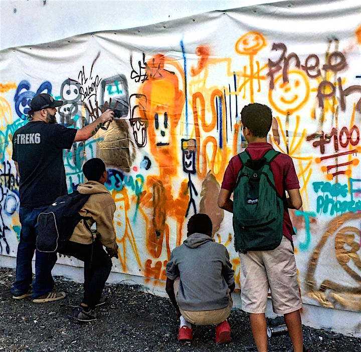 trek6 with youth <em>Street Art for Mankind</em> Battles Child Slavery with: Bruno Smoky &amp; Shalak Attack, Mr. Cenz, Mr. Dheo, Victor Ash, Jo Di Bona, Trek6 and more