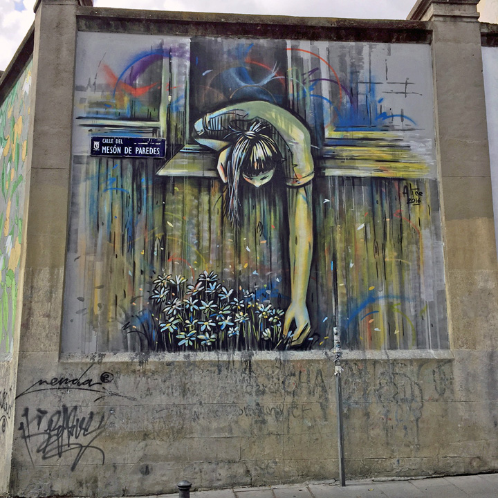 Alice pasquini street art mural madrid spain <em>Muros Tabacalera</em> in Madrid, Spain with: Alice Pasquini, Dadi Dreucol, Animalitoland, Digo Diego, Nano 4814, Okuda, Ruben Sanchez, Add Fuel and Gripface